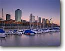 Stock photo. Caption: Dawn at Puerto Madero Buenos Aires Argentina South America -- travel destination destinations attraction attractions tourist boats boat sailboat sailboats city cityscape cityscapes port ports international South America latin