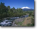 Stock photo. Caption: Rio Blanco River   and Calbuco Volcano Andes Mountains Chile, South America -- travel destination destinations attraction attractions tourist  international parks rivers volcanoes volcanos snow capped volcanic runoff landscape landscapes South America latin landmarks landmark