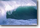 Stock photo. Caption: Breaking wave Montara State Beach San Mateo County California -- waves surf crashing spume translucent foam curl curling united states america power powerful strength spewm pacific west coast winter heavy