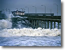 Stock photo. Caption: Ocean Beach Pier   in winter storm San Diego County California --  seascape seascapes united states america pacific power powerful coast coasts north headland crashing cove coves waves storm storms stormy clouds powerful parks west churning piers