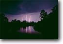 Stock photo. Caption: Lightning, Combahee River from Cuckhold Creek ACE Basin Colleton Co., South Carolina -- thunderstorm thunderstorms night bolt bolts rivers county thunder south  southeast southeastern united states america violent weather storm storms stormy nightime severe threatening