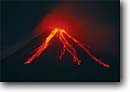Stock photo. Caption: Arenal Volcano erupting at night    as seen from Lake Arenal Arenal Volcano National Park Alajuela Province, Costa Rica -- central america tropical destination destinations travel tourist attraction attractions ecotourism volcanic volcanoes eruption eruptions erupting cone parks vulcanism lava flowing fire flow flows active volcanos geology geologic landscape landscapes latin