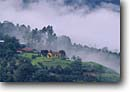 Stock photo. Caption: Church in dawn mist   near Turrialba Cartago Province Costa Rica -- churches rural morning misty fog foggy central america religion religious place worship catholic christian christianity latin american landscape landscapes building buildings scenics scenic views view