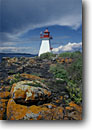 Stock photo. Caption: Lighthouse on Shaganash Island Lake Superior   east of Thunder Bay Ontario,  Canada -- light lights station stations lighthouses lakes parks great lakes region canadian beacon beacons direction guidance pharos navigation navigational aid aids midwestern midwest solid secure building buildings landscape landscapes rocky rock white