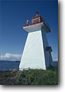 Stock photo. Caption: Lighthouse on Shaganash Island Lake Superior   east of Thunder Bay Ontario,  Canada -- light lights station stations lighthouses lakes parks great lakes region canadian beacon beacons direction guidance pharos navigation navigational aid aids midwestern midwest solid secure building buildings summer landscape landscapes white