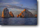 Stock photo. Caption: Cabo San Lucas Bahia San Lucas Baja California Mexico -- offshore islands arch arches mexican pacific ocean tropical destination vacation destinations ocean oceans rocks clouds cloudy solid island western west latin