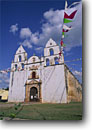 Stock photo. Caption: Church Oxkutzcab Yucatan Mexico --  travel tourist destination destinations spring attraction attractions religion religious site sites international holy bells bell churches mexican building buildings historic historical facade tower white sunny blue skies flags landscape latin landscapes