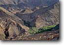 Stock photo. Caption: Green fields   near Lamayuru Monastery Himalayas,  Ladakh Jammu and Kashmir, India -- Keywords: international travels travel trip trips vacation vacations april spring  tourist destination destinations attraction attractions scenic agriculture farm farming terrace terraces terracing foreign asia asian