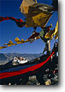 Stock photo. Caption: The Potala Palace   viewed through prayer flags, Lhasa The Himalayas Tibet, China -- international travels travel history historical tourist destination destinations attraction attractions asia asian sunny temples palaces ornate buildings building architecture chinese ancient blue skies scenic scenics views view flag traditional tradition