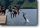 Stock photo. Caption: Local kids at play Gau Island Fiji Indo-Pacific -- native polynesian children diving swimming playing dock docks tropical destination destinations tourist world travel sunny playful south ocean ocean travel dive fijian people children child