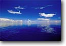 Stock photo. Caption: Convection clouds over open ocean Vanua Levu Barrier Reef Fiji Indo-Pacific -- tropical travel destination destinations tourist calm waters south cloud calm placid tranquil seas reflection reflections paradise blue water exotic peace peaceful reefs  horizon ocean breathtaking seascape seascapes