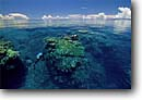Stock photo. Caption: Coral reef from above Vanua Levu Barrier Reef Fiji Indo-Pacific -- tropical travel destination destinations tourist calm waters south cloud calm placid tranquil seas reflection reflections reefs corals paradise horizon exotic water ocean snorkeling dive diving seascape seascapes divers people
