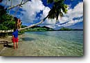 Stock photo. Caption: Tourists enjoy the beach   and coconut palms Gau Island,  Fiji Indo-Pacific --   tropical destination destinations tourist calm waters south clouds calm placid tranquil balance bright purity site site travel traveler travelers vacation vacations beaches companionship love palm emerald palm paradise ocean sea people