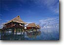 Stock photo. Caption: Hotel over lagoon Raiatea Society Islands French Polynesia -- Keywords: tropical polynesian destination destinations tourist travel expensive hotels accomodations thached roof roofs stilts tropic vacation vacations exotic getaway getaways blue clear sunny sky skies warm places high end