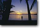 Stock photo. Caption: Girl on beach at sunset Raiatea Society Islands French Polynesia -- Keywords: tropical polynesian destination destinations tourist travel tropic vacation vacations exotic getaway getaways blue clear sunny sky skies warm places people woman women silhouette silhouettes sunset palm trees tree palms coconut