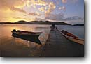 Stock photo. Caption: Sunrise Mochima National Park Mochima Venezuela,  South America -- travel tourist destination destinations sunrises dock docks fishing boat boats parks bay bays peaceful tranquil dawn dawns latin