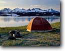 Stock photo. Caption: Lost Lake Chugach National Forest Kenai Peninsula Alaska -- tent camping backpacking tents mountains lakes united states america snow capped campsite campsites solitude remote wilderness remote backcountry  outdoor recreation summer isolation alpine subalpine pristine clarity