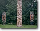 Stock photo. Caption: Totem poles Sitka National Historical Park Sitka, Baranof Island Southeast Alaska -- pole native american alaskan carve carving tree trees indian arts majestic artistic spiritual northwest mystical history historical united states america religious totems power family icon icons beliefs belief animal motif mystic summer