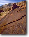 Stock photo. Caption: Anasazi Petroglyphs and the Vermilion  Cliffs, Paria Canyon-Vermilion  Cliffs Wilderness Colorado Plateau,  Arizona -- deserts petroglyph red rock country art southwest ancient boulder fall autumn united states america ancient civilization civilizations warm native american communication spiritual country canyon indian ancient artist artists cliff