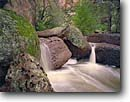 Stock photo. Caption: Virgus Canyon Aravaipa Canyon Wilderness Sonoran Desert,  Arizona -- waterfall waterfalls deserts spring   southwest southwestern landscape landscapes canyons united states america runoff boulder boulders wildernesses bureau land management resource area areas backpack rains hiking backcountry creek creeks stream streams