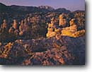 Stock photo. Caption: Cochise Head   from Heart of the Rocks Chiracahua National Monument Chiracahua Mountains,  Arizona -- welded tuft canyons monuments landscape landscapes united states america southwest southwestern rocky canyons canyon red rock spring  hoodoos spire spires column columns
