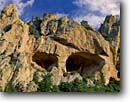 Stock photo. Caption: Skull Eyes,Cave Creek Canyon Chiracahua Mountains Coronado National Forest Arizona -- united states america welded tuff tuffs face faces skulls eye rock stone erosion eroded southwest southwestern landscape landscapes artistic nature alcove alcoves landmark landmarks  spring