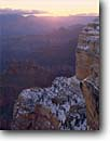 Stock photo. Caption: Sunrise over Grand Canyon    from Hopi Point Grand Canyon National Park Colorado Plateau,  Arizona -- canyons parks mood moody vista vast  united states america world heritage site sites landscape landscapes tourist destination destinations attraction attractions snow cold winter snowy south rim travel new fresh sunrises red rock country
