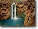 Stock photo. Caption: Mooney Falls and Havasu Creek Havasu Canyon Havasupai Indian Reservation Colorado Plateau,  Arizona -- united states america creek waterfall waterfalls sandstone red rock travertines redwall limestone canyons reservations terrace terraces southwest southwesten landscape landscapes wisdom spring red rock country plunge plunges pool pools