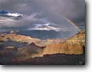 Stock photo. Caption: Rainbow over Yaki Point   from Mather Point,  Grand Canyon Grand Canyon National Park Colorado Plateau,  Arizona -- rainbow rainbows light dramatic  spectacular evening parks inspirational inspiring vista canyons parks vacation travel destination destinations southwest desert united states america world heritage site sites weather summer thunderstorm thunderstorms