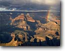 Stock photo. Caption: Rainbow over Isis Temple   from Hopi Point,  Grand Canyon Grand Canyon National Park Colorado Plateau,  Arizona -- rainbow rainbows light dramatic  spectacular evening parks inspirational inspiring vista canyons parks vacation travel destination destinations southwest desert united states america world heritage site sites weather summer thunderstorm thunderstorms