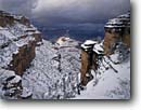 Stock photo. Caption: The Battleship in Grand Canyon   from Bright Angel Trail,  South Rim Grand Canyon National Park Colorado Plateau,  Arizona -- canyons parks mood moody vista spectacular dramatic united states america world heritage site sites landscape landscapes tourist travel destination destinations snow cold winter snowy clearing storm storms stormy fresg snowfall family vacation blanket