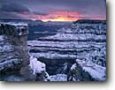 Stock photo. Caption: Sunrise over Grand Canyon Mather Point, South Rim Grand Canyon National Park Colorado Plateau, Arizona -- canyons country world heritage site sites parks snow winter snowy  cold clouds cloudy clearing storm dramatic awesome shadows united states america solitude adversity sunrises travel tourist destination destinations wintery clearing storm storms