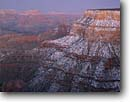Stock photo. Caption: Grand Canyon from near Mather Point South Rim Grand Canyon National Park Colorado Plateau,  Arizona -- canyons parks mood moody vista spectacular dramatic united states america world heritage site sites landscape landscapes tourist travel destination destinations snow cold winter snowy clearing storm storms stormy fresg snowfall family vacation blanket