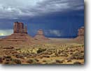 Stock photo. Caption: Lightning over Mitten Buttes Monument Valley Navajo Tribal Park Colorado Plateau, Arizona -- indian native american canyon country parks deserts storm stormy butte southwest dramatic bolts thunderstorm summer monsoon strike strikes united states america power energy landscape landscapes destination famous landmark landmarks red rock thunderstorms