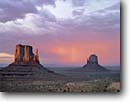 Stock photo. Caption: East and West Mitten Buttes Monument Valley Navajo   Tribal Park Colorado Plateau, Arizona -- indian native american canyon country parks deserts storm stormy butte southwest dramatic bolts thunderstorm summer monsoon strike strikes united states america power energy landscape landscapes destination famous landmark landmarks red rock thunderstorms