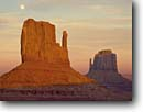 Stock photo. Caption: Moonrise over the Mitten Buttes Monument Valley Navajo Tribal Park Navajo Nation Colorado Plateau,  Arizona -- indian native american canyon country parks deserts butte southwest dramatic united states america symetry landscape landscapes travel tourist destination destinations attraction attractions moon moons mittens landmark landmarks moonrises sunset sunsets