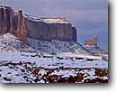 Stock photo. Caption: Sentinel Mesa and Stagecoach Monument Valley Monument Valley Tribal Park Arizona,  Utah -- indian native american canyon country parks deserts storm stormy butte southwest southwestern united states america symetry landscape landscapes travel tourist destination winter snow snowy cold destinations weather fresh snowfall snowfalls rock