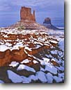 Stock photo. Caption: West and East Mitten Buttes Monument Valley Tribal Park The Navajo Nation Colorado Plateau, Arizona -- indian native american canyon country parks deserts storm stormy butte southwest southwestern united states america symetry landscape landscapes travel tourist destination winter snow snowy cold destinations weather fresh snowfall snowfalls red rock
