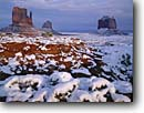 Stock photo. Caption: West and East Mitten   and Merrick Buttes Monument Valley Navajo Tribal Park Colorado Plateau, Arizona -- indian native american canyon country parks deserts storm stormy butte southwest southwestern united states america symetry landscape landscapes travel tourist destination winter snow snowy cold destinations weather fresh snowfall snowfalls red rock