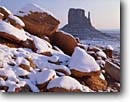 Stock photo. Caption: West  Mitten Butte Monument Valley Monument Valley Navajo Tribal Park Colorado Plateau,  Arizona -- indian native american canyon country parks deserts storm stormy butte southwest southwestern united states america symetry landscape landscapes travel tourist destination winter snow snowy cold destinations weather fresh snowfall snowfalls red rock