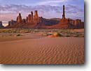 Stock photo. Caption: Totem Pole,  Monument Valley Monument Valley Tribal Park Navajo Nation Colorado Plateau,  Arizona -- indian native american canyon country deserts parks dune buttes sand dunes ripples evening butte ripple spire sandy southwest western painted desert united states america desolate arid  landmark landscape landscapes landmarks movie sets icon western icons