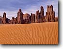 Stock photo. Caption: Yei Be Chei Rocks Monument Valley Navajo Tribal Park The Navajo Nation Colorado Plateau,  Arizona -- indian native american canyon country deserts parks dune buttes sand dunes ripples evening butte ripple spire sandy southwest western painted desert united states america desolate arid reservation reservations landmark landmarks landscape landscapes