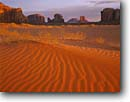 Stock photo. Caption: Sand dunes at sunrise Monument Valley Tribal Park The Navajo Nation Colorado Plateau,  Arizona -- indian native american canyon country deserts parks dune buttes sand dunes ripples evening butte ripple spire sandy southwest western painted desert united states america desolate arid reservation reservations landmark landmarks landscape landscapes