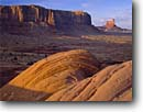 Stock photo. Caption: Sentinel Mesa and Stagecoach Monument Valley Monument Valley Tribal Park Arizona, Utah -- united states landscape landscapes clear scenic scenics scene canyons country parks distance view views vista vistas plateaus slickrock native american land lands sites site parks indian tribes owned landmarks landmark formation named formations deserts