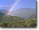 Stock photo. Caption: Rainbow over Miller Peak Huachuca Mountains Coronado National Forest Arizona -- southwest southwestern rock country canyon remote canyons plateaus distance rock erosion eroded evolution landscape landscapes scenic scenics rainbows weather phenomenon sagebrush scene distance view vistas