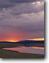 Stock photo. Caption: Sunrise at Big Lake Apache National Forest White Mountains Colorado Plateau,  Arizona -- storm stormy southwest thunderstorm summer monsoon united states america symetry power energy exciting landscape landscapes destination tranquil sunrises lakes reservoir reservoirs reflection reflections