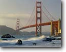 Stock photo. Caption: Golden Gate Bridge   from Baker Beach Golden Gate National Recreation Area San Francisco,  California -- united states america seascape seascapes areas west pacific ocean highways scenic travel destination vacation bridges strength symbol symbols gateway beaches waves surf icon icons motion suspension tourist destinations city clear landmark landmarks
