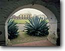 Stock photo. Caption: Plaza Hotel   from Mission San Juan Bautista San Juan Bautista State Historical Park San Benito County,  California -- agave agaves missions church churches religion religious foggy light united states america missionary period spanish catholic christian christianity arch arches walkway walkways adobe planting garden gardens looking through history
