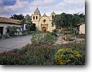 Stock photo. Caption: Mission San Carlos Borromeo  del Rio Carmel Carmel, Monterey  County California -- missions flowers plaza plazas historic historical united states america building buildings catholic religion religious site sites spanish missionaries worship holy places place christian christianity adobe cross crosses church churches tourist attractions