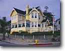 Stock photo. Caption: The Seven Gates Inn Bed and Breakfast Pacific Grove Monterey Peninsula Monterey County, California -- inns victorian victorians home homes houses house historic historical breakfasts yellow fire hydrant hydrants american flag flags united states america picturesque quaint vintage houses